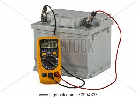 Checking Voltage Of Automotive Battery, Isolated On White Background