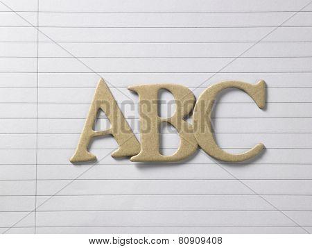 close up of alphabet a b c on single line book