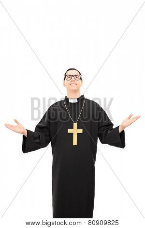 Vertical shot of a young catholic priest looking up isolated on white background