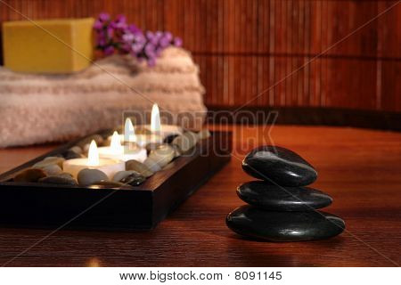 Polished Stone Cairn With Candles In A Spa