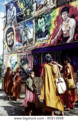 Monks Watch The Advertising Of A Cimena