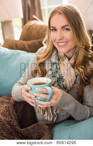 Young woman with a large mug of tea