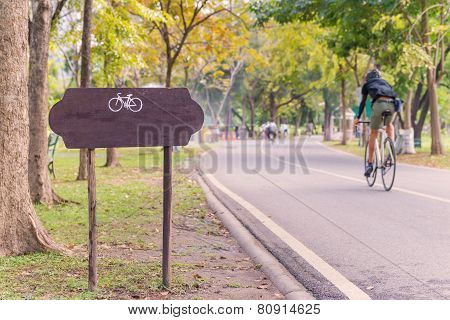 Exercise With Bicycle In Public Park