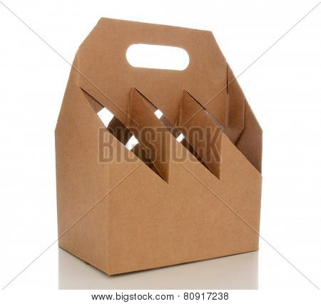 Closeup of an empty six pack carrier. The cardboard carrier is blank and isolated on white with reflection.