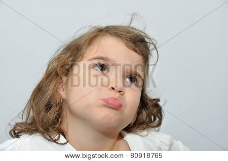 Young girl pouting