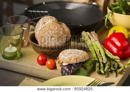 Fresh Vegetables And Rolls In A Kitchen