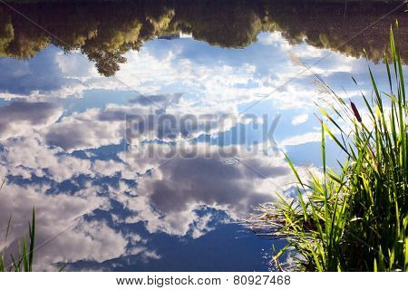 Sky With Clouds Reflecting In The Water