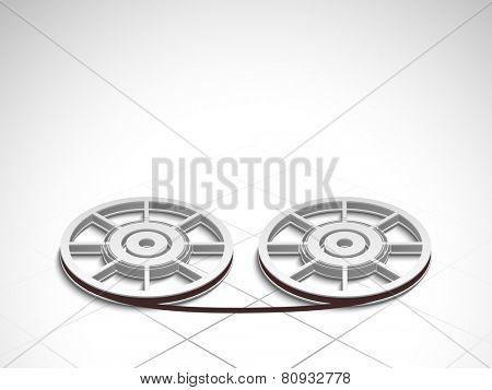 Film reels on stylish shiny light grey background.