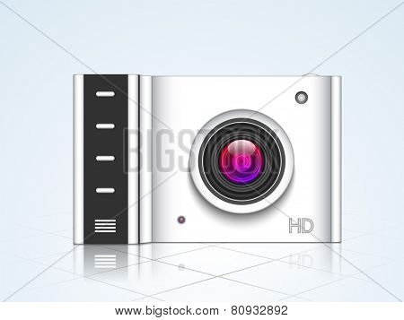 Camera for photography on shiny light sky blue background.