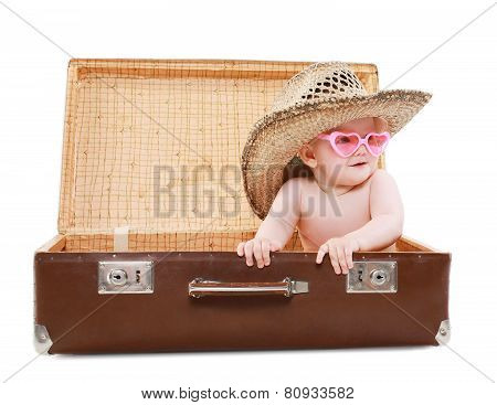 Travel, Vacation And People Concept - Funny Baby In Sunglasses And Summer Straw Hat Looks Out Of A S