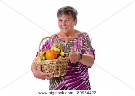 Senior Woman With Basket Of Fruit