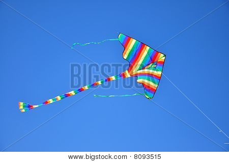 stripy kite isolated at the sky
