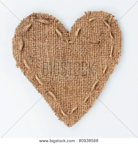 Symbolic Heart Of Burlap Lies On A White Background
