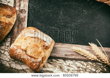 Rustic Frame With Bread And Wheat