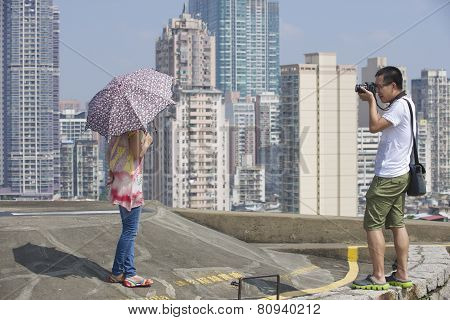 People do travel photography in Macau, China.