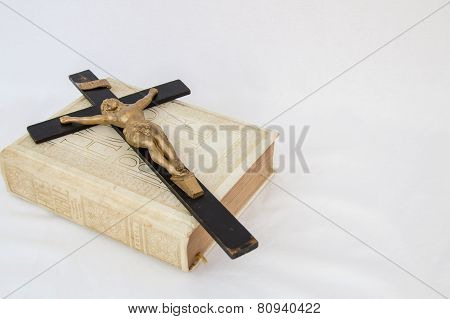 Antique Crucifix On A Cream Colored Bible