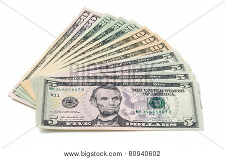Dollar bills fanned out on a white background