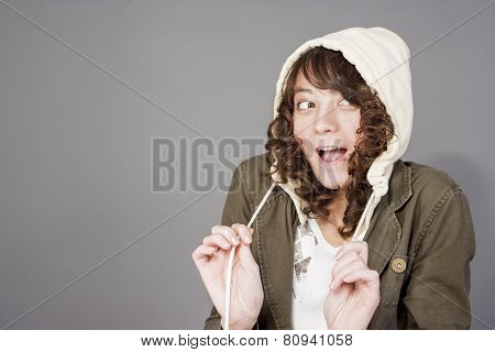Cute And Funny Young Caucasian Girl With Long Curly Hair With Surprised Facial Expression
