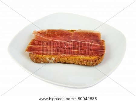 Serrano ham whith bread. Spanish tapa. Mediterranean diet.
