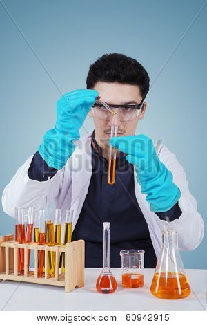 Caucasian Scientist Doing Chemical Experiment