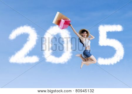 Girl With Shopping Bag Jumping On The Sky