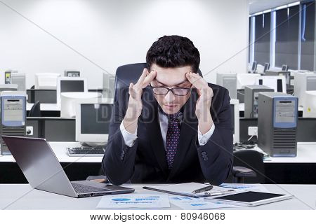 Male Manager Having Headache Pain
