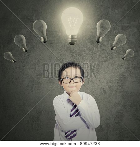 Schoolboy Under Bright Lightbulb