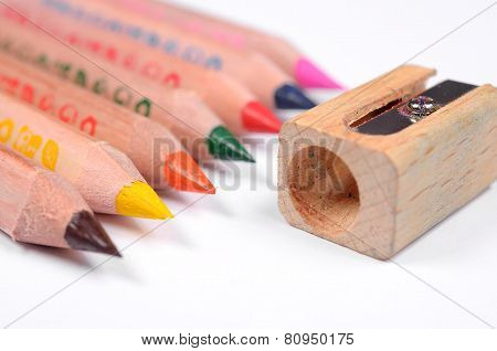 Set of bright colored pencils and knife-sharpener
