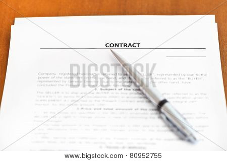 Silver Pen On Sheet Of Sales Contract On Table