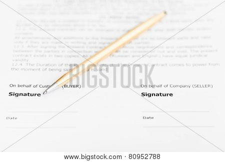 Golden Pen On Signature Page Of Agreement