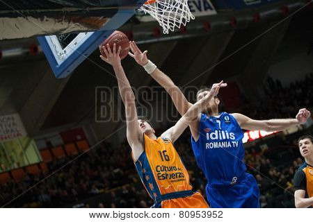 VALENCIA, SPAIN - JANUARY 21: Vives 16 and Pelekanos during Eurocup match between Valencia Basket Club and CSU Asesoft at Fonteta Stadium on January 21, 2015 in Valencia, Spain