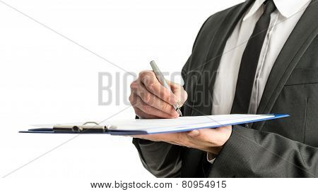 Side View Of A Businessman Signing Legal Papers On A Map With Fountain Pen