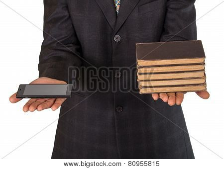 Businessman's Hands Offering Choice Between Obsolete Books Or Smartphone Isolated