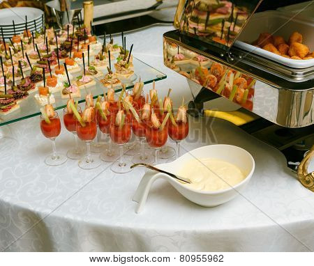 Catering - Served Table With Various Snacks, Canape And Appetizers And Gravy Boat