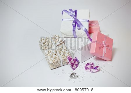 Cute gift boxes on the gray background