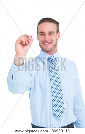 Smiling businessman in shirt writing with marker on white background