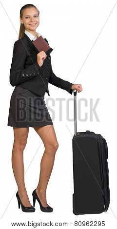 Businesswoman with suitcase and passport