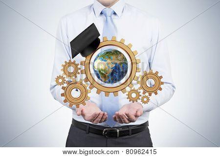Businessman Holding Gears