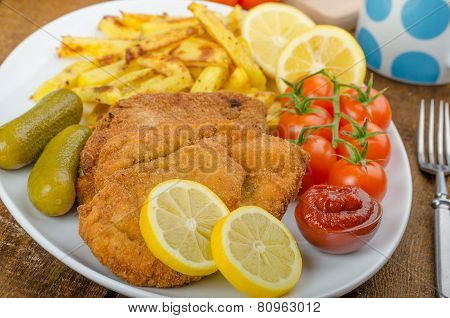 Big Chicken Schnitzel With Homemade Chilli French Fries