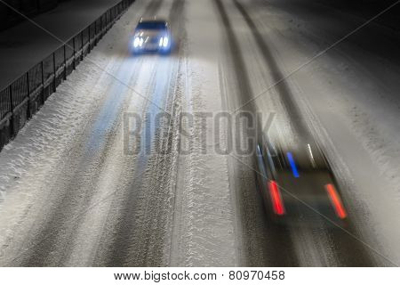 Two Cars On Winter Road