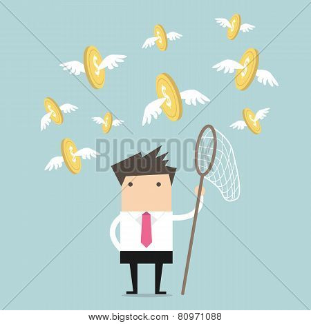 Businessman catch flying coins