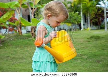 Baby Girl With The Watering Can