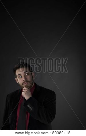Thoughtful Businessman Looking Up with Copy Space