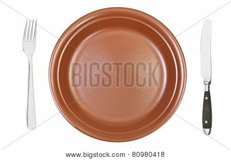 Top View Of Empty Brown Dinner Plate With Cutlery