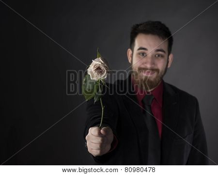 Happy Man in Formal Suit Offering Rose