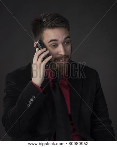 Happy Businessman in Talking Through Phone