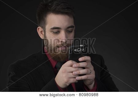 Serious Businessman Using his Mobile Phone