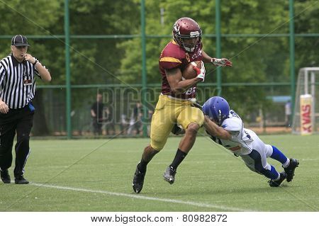Belgrade Serbia - May 05 2014: Team the Wolves in action. American Football Match Between Belgrade Wolves And Blue Dragon in Belgrade. The Wolves team is winner.