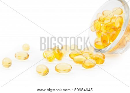 Omega 3 Fish Oil Capsules And Glass.