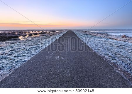 Desolate Road In A Winter Rural Landscape